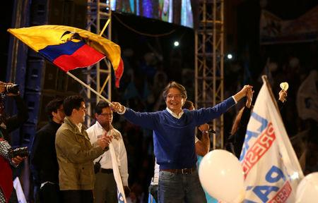 Presidential candidate Guillermo Lasso, from the CREO party holding an Ecuadorean flag arrives to campaign rally in Quito, Ecuador, March 29, 2017. REUTERS/Mariana Bazo