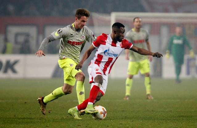 Soccer Football - Europa League - Red Star Belgrade vs FC Cologne - Rajko Mitic Stadium, Belgrade, Serbia - December 7, 2017 Red Star Belgrade's Guelor Kanga in action with Cologne's Lukas Klunter REUTERS/Novak Djurovic