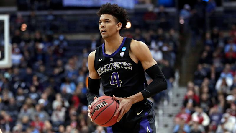 Washington's Matisse Thybulle looks to pass against Utah State in the first half during a first round men's college basketball game in the NCAA Tournament in Columbus, Ohio, Friday, March 22, 2019. (AP Photo/Tony Dejak)