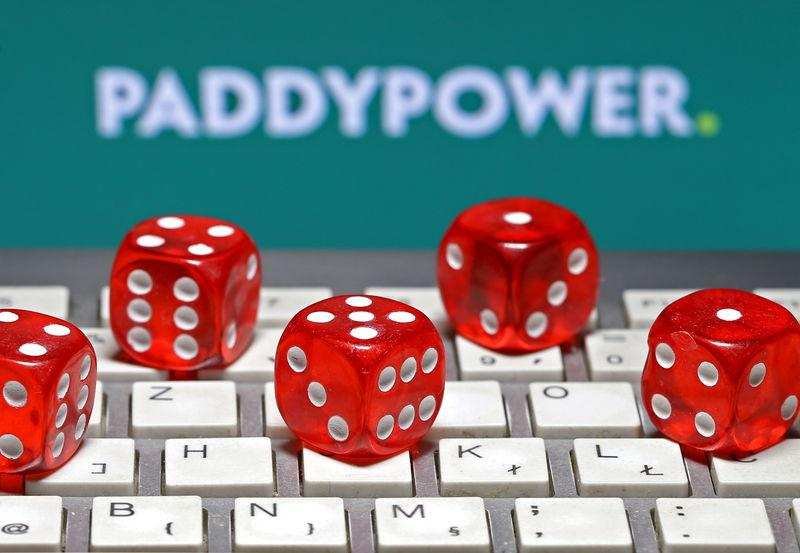 Paddy Power logo is seen behind a keyboard and gambling dice in this illustration taken in Sarajevo