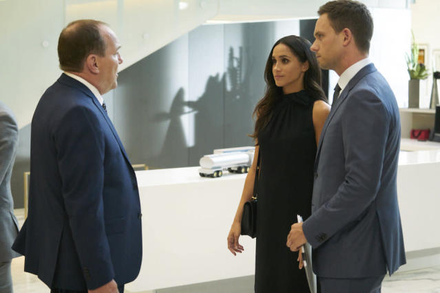 "Meghan Markle as Rachel Zane stands beside Patrick J. Adams as Mike Ross in ""Suits."" (Photo: Ian Watson/USA Network)"