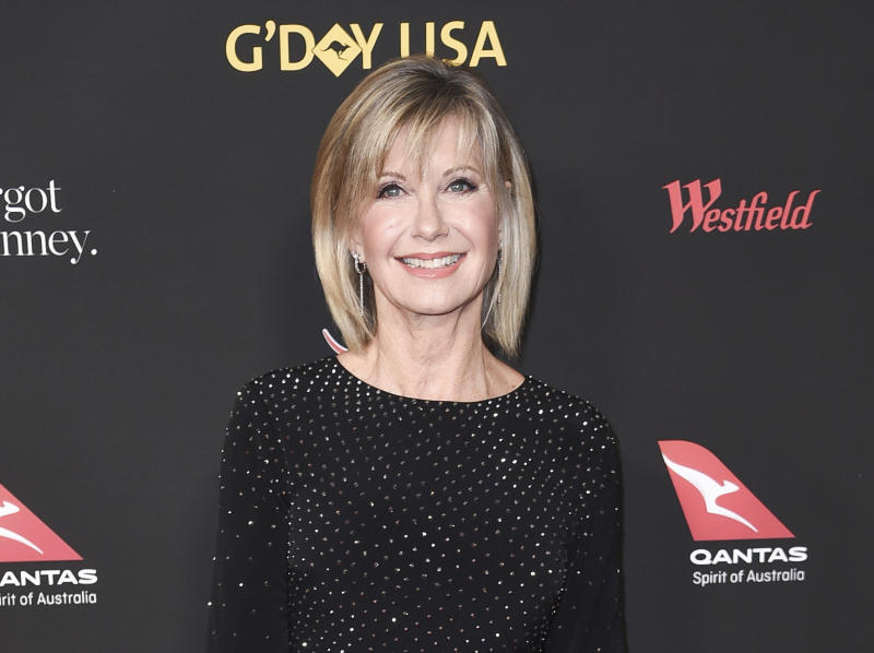 "FILE - In this Jan. 27, 2018 file photo, Olivia Newton-John attends the 2018 G'Day USA Los Angeles Gala at the InterContinental Hotel Los Angeles. Newton-John's autobiography, released last fall in Australia, will out in the U.S. in 2019. Gallery Books, an imprint of Simon & Schuster, announced Tuesday, Dec. 18, that ""Don't Stop Believin'"" would be published March 12. (Photo by Richard Shotwell/Invision/AP, File)"