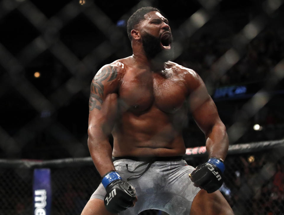 Curtis Blaydes celebrates his win over Alistair Overeem  in a heavyweight UFC 225 Mixed Martial Arts bout Saturday, June 9, 2018, in Chicago. (AP Photo/Jim Young)