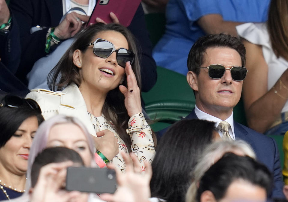 US actor Tom Cruise with actress Hayley Atwell, left watch the women's singles final between Australia's Ashleigh Barty and Czech Republic's Karolina Pliskova on day twelve of the Wimbledon Tennis Championships in London, Saturday, July 10, 2021. (AP Photo/Kirsty Wigglesworth)