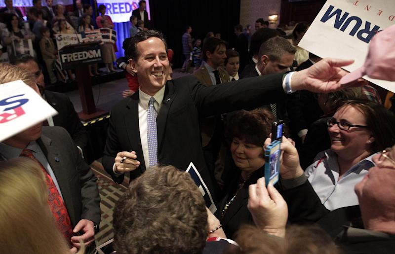 FILE - In this April 3, 2012 file photo, Republican presidential candidate, former Pennsylvania Sen. Rick Santorum greets supporters in Cranberry, Pa. Republican presidential candidate Rick Santorum's plan to use state conventions to pull support from Mitt Romney has stalled in North Dakota, where Romney has the largest group of backers among the state's national convention delegates. (AP Photo/Jae C. Hong, File)