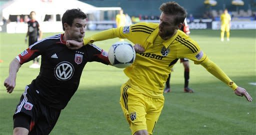 Columbus Crew midfielder Eddie Gaven, right, and D.C. United midfielder Chris Pontius, left, battle for the ball during the second half of an MLS soccer game on Saturday, March 23, 2013, in Washington. Columbus won 2-1. (AP Photo/Nick Wass)