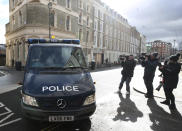 A police van arrives at Westminster Magistrates' Court, in London, Saturday March 13, 2021. London police arrested a member of the force's Parliamentary and Diplomatic Protection Command on Tuesday as a suspect in the case of the disappearance of Sarah Everard. Late Friday police charged the officer, Constable Wayne Couzens, with kidnapping and murder. Couzens, 48, was due to appear in court on Saturday. (Steve Parsons/PA via AP)