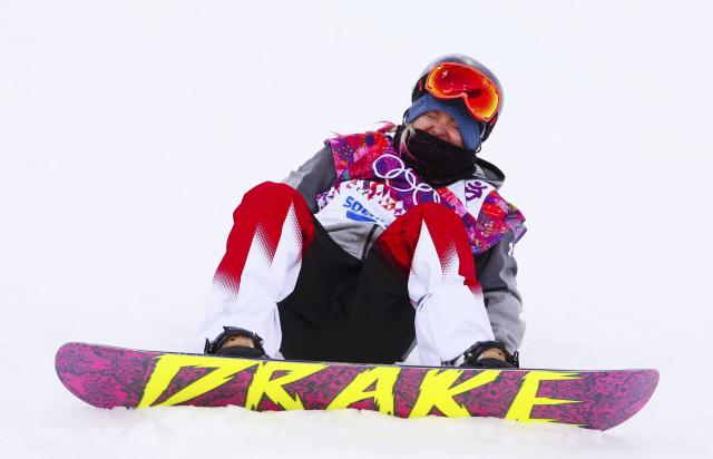 Canada's Nicoll reacts after crashing during the women's snowboard halfpipe qualification round at the 2014 Sochi Winter Olympic Games in Rosa Khutor