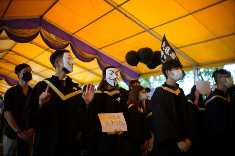 The Chinese University of Hong Kong (CUHK) students donned face masks to display outlawed slogans and defy the new national security law imposed by Beijing