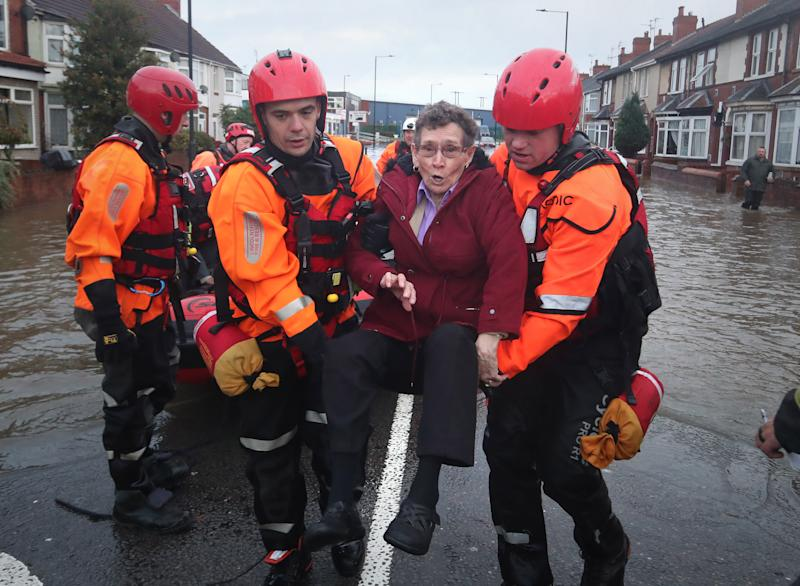 Fire and Rescue service members rescue residents trapped by floodwater in Doncaster, Yorkshire, as parts of England endured a month's worth of rain in 24 hours, with scores of people rescued or forced to evacuate their homes, others stranded overnight in a shopping centre, and travel plans thrown into chaos. PA Photo. Picture date: Friday November 8, 2019. See PA story WEATHER Rain. Photo credit should read: Danny Lawson/PA Wire