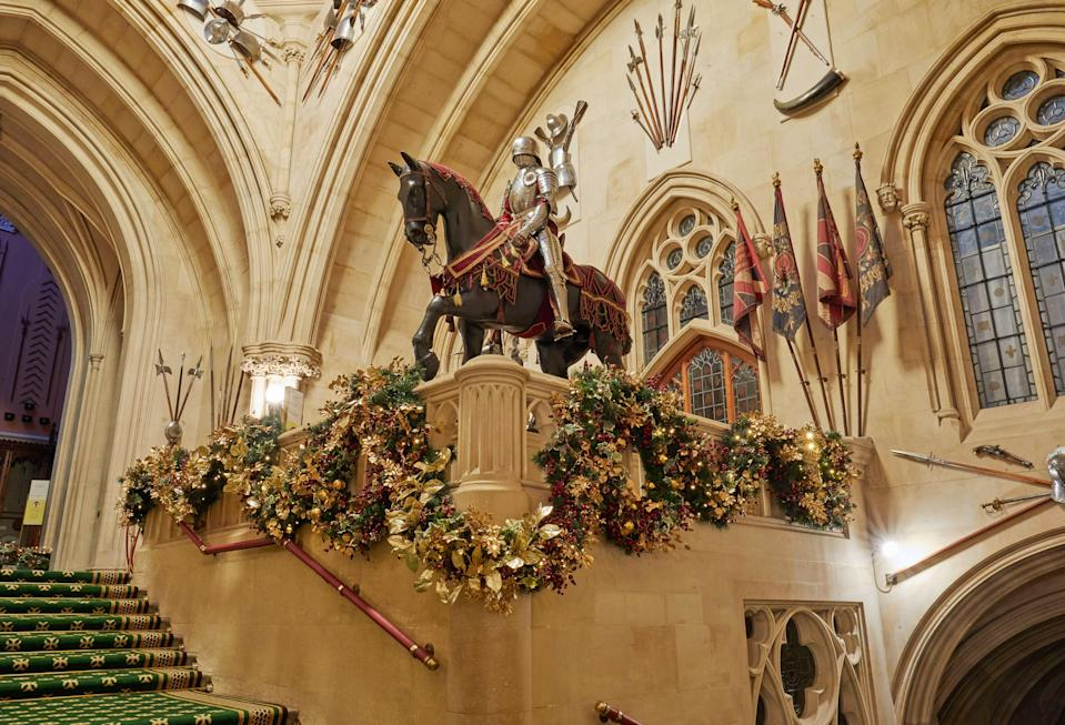 For single use only in relation to the Christmas displays at Windsor Castle in 2020, not to be archived, sold on or used out of context. Undated handout photo issued by the Royal Collection Trust of festive garlands adorn the Grand Staircase at Windsor Castle.
