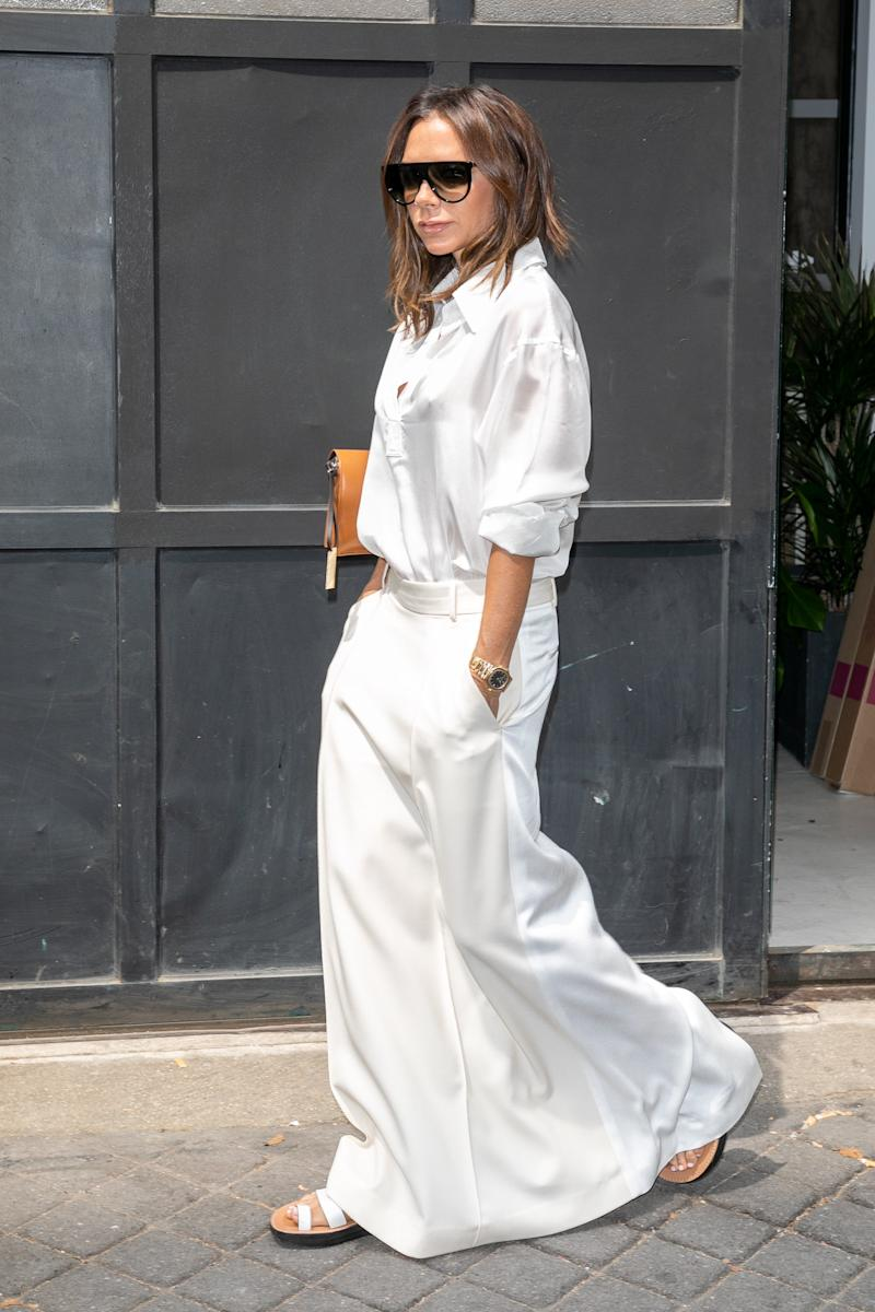 WHO: Victoria Beckham<br />WHAT: Victoria Beckham, Céline shoes and sunglasses<br />WHERE: On the street, Paris<br />WHEN: July 5, 2018