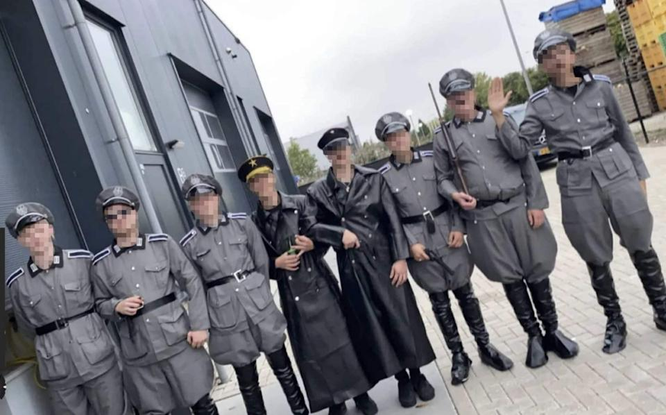Dutch youths spark fury by parading through village dressed as Nazi's to protest coronavirus restricitons