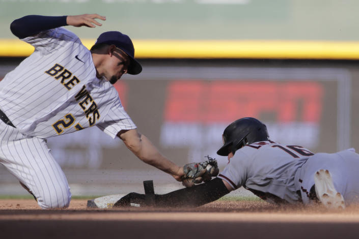 Arizona Diamondbacks' Tim Locastro (16) is caught stealing as he's tagged out at second base by Milwaukee Brewers' Willy Adames during the eighth inning of a baseball game Saturday, June 5, 2021, in Milwaukee. (AP Photo/Aaron Gash)