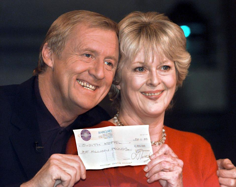 Who Wants to Be A Millionaire winner Judith Keppel (right) receiving a cheque from Chris Tarrant at a photo call at Elstree studios in London.  She has become the first contestant to scoop the  1million jackpot on the hit quiz show Who Wants To Be A Millionaire?  *... Viewers have already seen Mrs Keppel - who is a relative of Camilla Parker Bowles, the partner of the Prince of Wales - win  16,000. But later, a show insider confirmed, the garden designer, who used up her Ask The Audience lifeline when she was stumped by the question asking her in which country was Prime Minister Tony Blair born, will go all the way to  1 million.   (Photo by Peter Jordan - PA Images/PA Images via Getty Images)