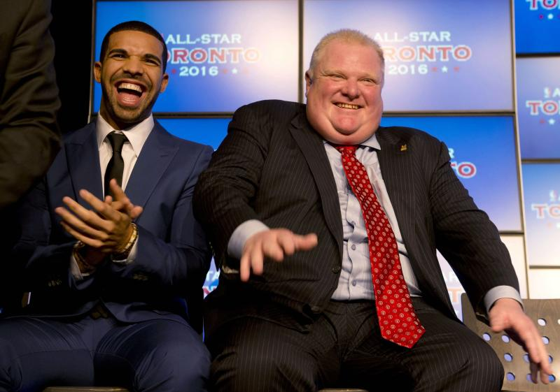Canadian recording artist Drake, left, and Toronto Mayor Rob Ford laugh at a news conference announcing that Toronto will host the 2016 NBA All-Star game, in Toronto, Monday, Sept. 30, 2013. (AP Photo/The Canadian Press, Frank Gunn)