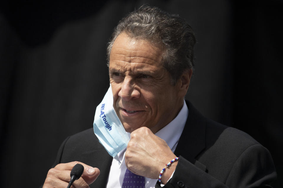 FILE - In this June 15, 2020, file photo, New York Gov. Andrew Cuomo removes a mask as he holds a news conference in Tarrytown, N.Y. The Justice Department vastly expanded its inquiry into whether New York is undercounting the number of nursing home residents dead from the coronavirus, demanding the state turn over death tallies from hundreds of private facilities. The demand ratchets up pressure on Cuomo after months of criticism from even members of his own party that the state's official tally of those dead from the disease at long-term care facilities is likely undercounted. (AP Photo/Mark Lennihan, File)