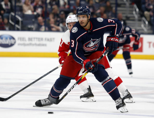 Columbus Blue Jackets defenseman Seth Jones, right, controls the puck in front of Detroit Red Wings forward Frans Nielsen, of Denmark, during the second period of an NHL hockey game in Columbus, Ohio, Thursday, Nov. 21, 2019. (AP Photo/Paul Vernon)
