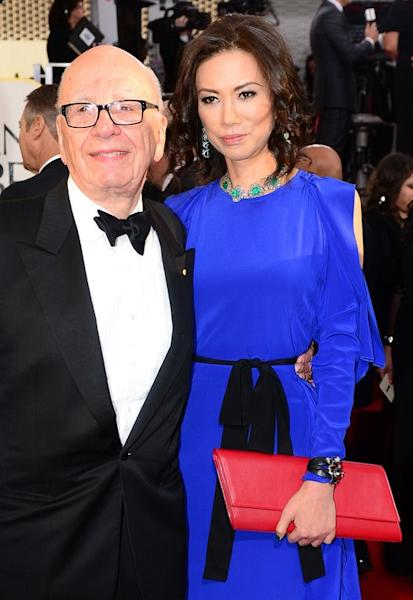 Rupert Murdoch and Wendy Deng arrive for the Golden Globe Awards in Beverly Hills, on January 13, 2013. Flamboyant Australian billionaire Clive Palmer on Thursday said he plans to sue Murdoch over unflattering allegations and claimed the media mogul's estranged wife Deng is a Chinese spy