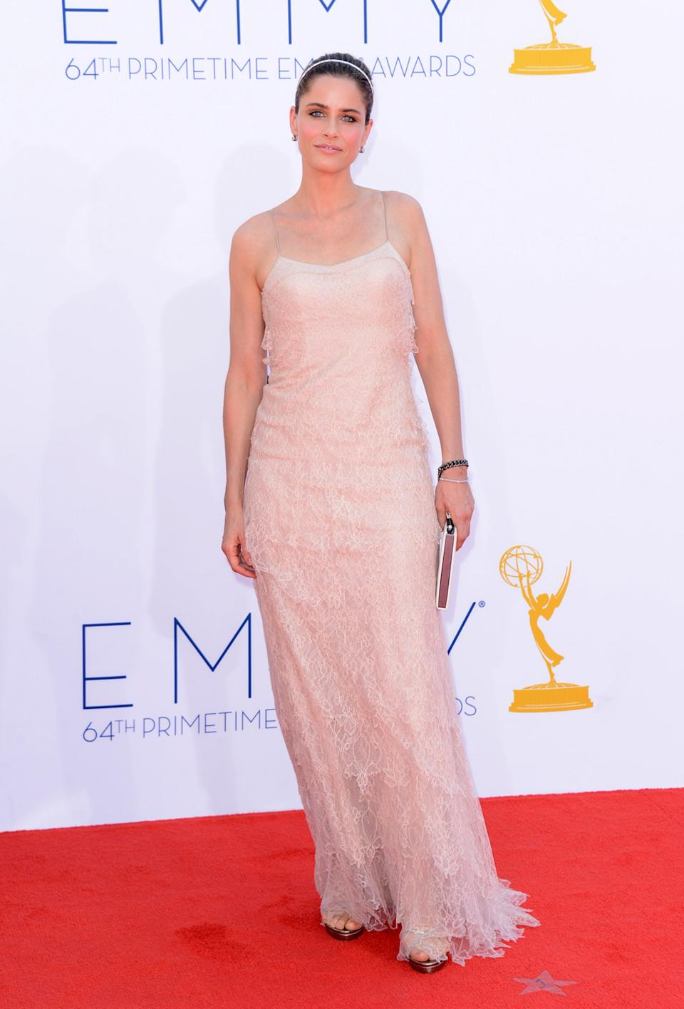 Actress Amanda Peet arrives at the 64th Primetime Emmy Awards at the Nokia Theatre in Los Angeles on September 23, 2012. (Photo by Jason Merritt/WireImage)