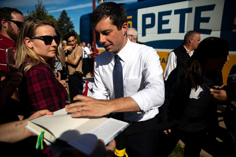 Pete Buttigieg, mayor of South Bend, Ind., signs an autograph after his campaign rally at Lyons Four Square Park on Tuesday, Sep. 24, 2019, in Clinton.