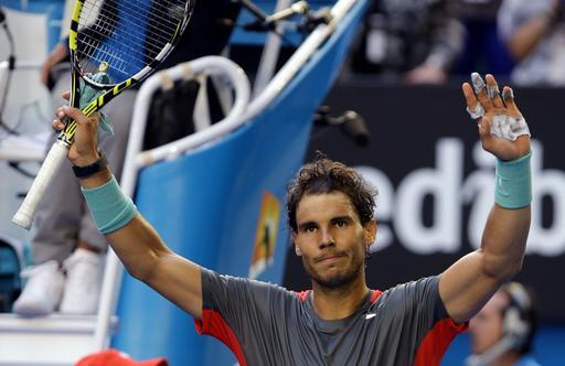 Rafael Nadal of Spain celebrates after defeating Kei Nishikori of Japan during their fourth round match at the Australian Open tennis championship in Melbourne, Australia, Monday, Jan. 20, 2014.(AP Photo/Aaron Favila)