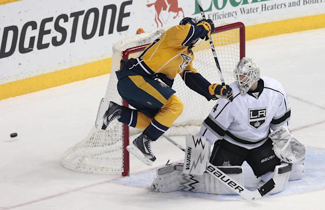 Nashville Predators forward Patric Hornqvist (27), of Sweden, jumps out of the way of a shot as it goes wide of Los Angeles Kings goalie Ben Scrivens during the second period of an NHL hockey game Saturday, Dec. 28, 2013, in Nashville, Tenn. (AP Photo/Mark Humphrey)