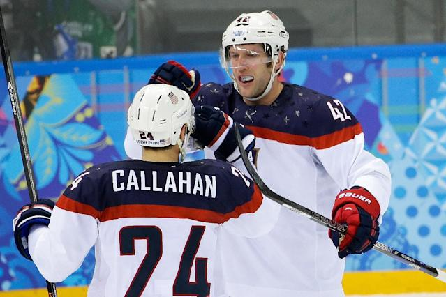 USA forward David Backes (42) celebrates his goal against the Czech Republic with teammate Ryan Callahan during the first period of men's quarterfinal hockey game in Shayba Arena at the 2014 Winter Olympics, Wednesday, Feb. 19, 2014, in Sochi, Russia. (AP Photo/Matt Slocum)