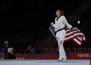 United States's Anastasija Zolotic celebrates as she holds her country national flag after winning a gold medal for the taekwondo women's 57kg match at the 2020 Summer Olympics, Sunday, July 25, 2021, in Tokyo, Japan. (AP Photo/Themba Hadebe)