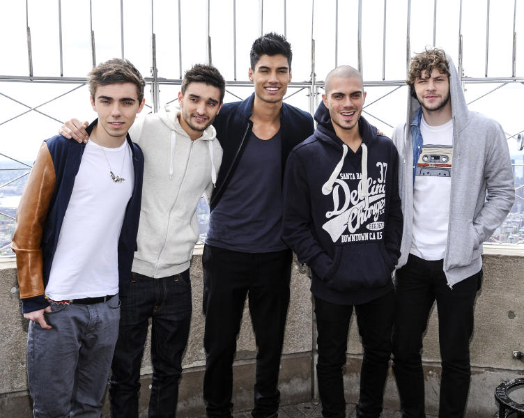 "FILE - In this April 24, 2012 file photo, British boy band ""The Wanted"", from left, Nathan Sykes, Tom Parker, Siva Kaneswaran, Max George and Jay McGuiness visit the Empire State Building in New York. Being a boy band has somewhat haunted the British based-quintet since their formation in 2009: They had to change record labels after being told to learn how to dance. But coming to America _ and achieving some success _ is a dream come true for the group. After releasing two top 5 albums and five hit singles in Europe, they've now duplicated some of that in America with the party jam ""Glad You Came,"" which has spent eight weeks in the top 10 on Billboard's Hot 100 chart. (AP Photo/Evan Agostini, file)"