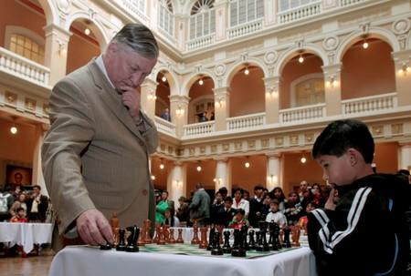 FILE PHOTO: Russian chess grandmaster Anatoly Karpov takes part in simultaneous chess games with students in La Paz