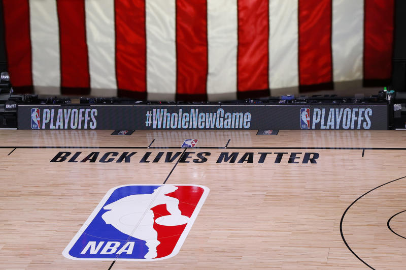 "An empty court in the NBA bubble, with the phrase ""Black Lives Matter"" painted on the floor."