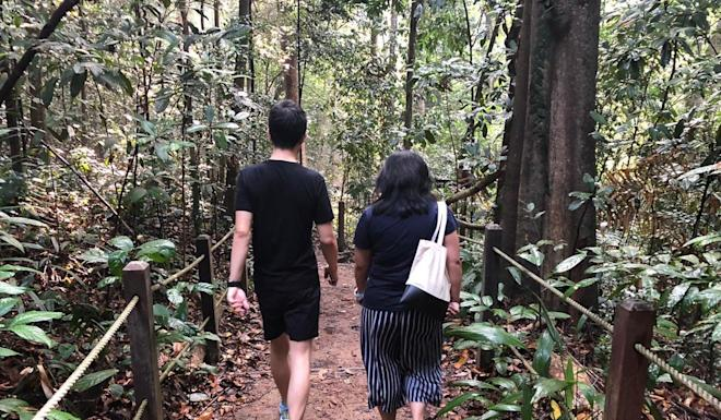 Carousell CEO Quek Siu Rui and Post reporter Zen Soo hiking at Singapore's Bukit Timah Hill. Photo: Jarieul Wong