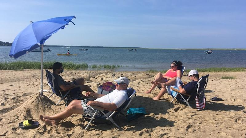 Zoe Fishman and family sunbathe on Cape Cod