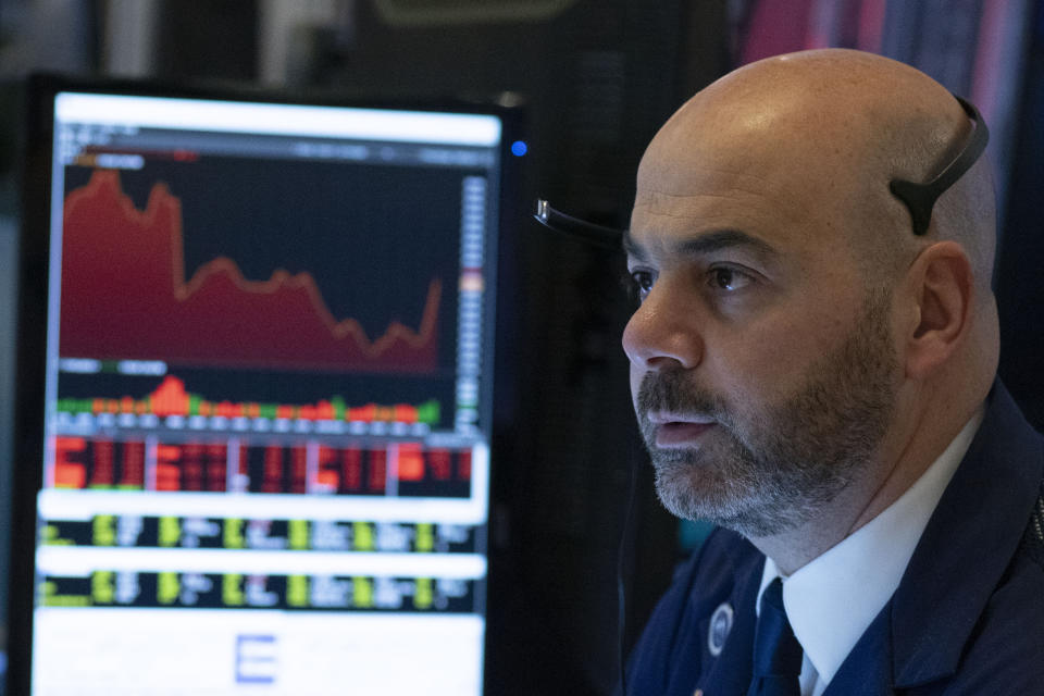 Trader Federico DeMarco works at the New York Stock Exchange, Wednesday, March 18, 2020 in New York.  Major U.S. stock indexes closed sharply lower on Wall Street Wednesday as fears of a prolonged coronavirus-induced recession took hold.  The Dow industrials lost more than 1,300 points, or 6.3%. After a brutal few weeks, the Dow has now lost nearly all of its gains since President Trump's inauguration. (AP Photo/Mark Lennihan)