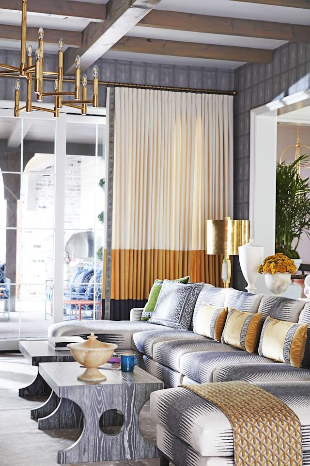 """<p>In <em>House Beautiful's </em>2019 Whole Home, design whiz <a href=""""https://www.housebeautiful.com/room-decorating/a29309887/whole-home-2019-living-room-foyer/"""" target=""""_blank"""">Vern Yip</a> showed how deep shades of golden yellow and brass can add glamour to layers of gray.</p>"""