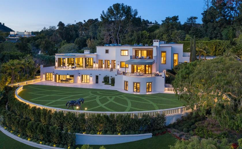Set on 2.7 acres, the contemporary mega-mansion spans 27,000 square feet and includes a guesthouse, swimming pool and tennis court.