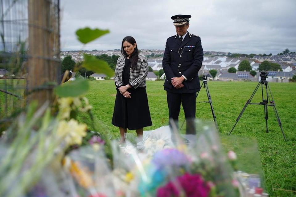 Home Secretary Priti Patel and Chief Constable of Devon and Cornwall Police, Shaun Sawyer, visiting tributes to the Keyham victims (PA) (PA Wire)