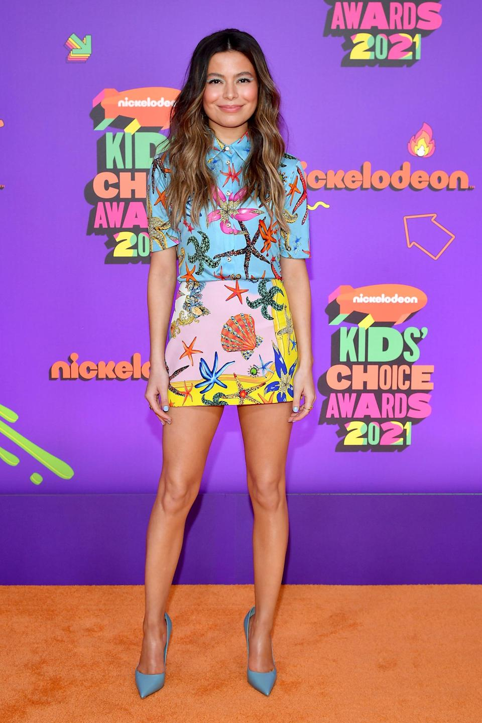<p>Wearing a Versace starfish-print outfit.</p>