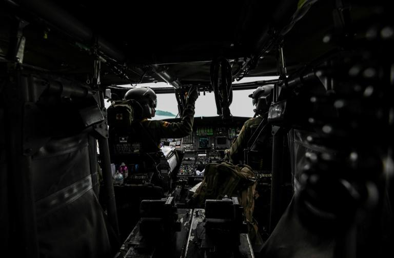 Colombian police pilots on board a helicopter during an operation to eradicate illicit coca crops in December 2020