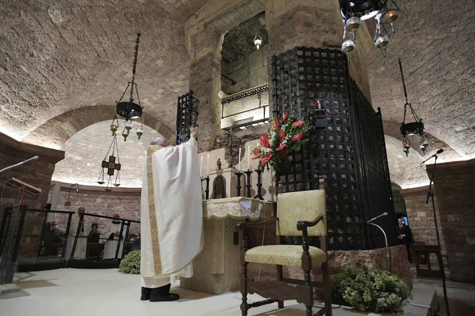 Pope Francis celebrates Mass in the crypt of the Basilica of St. Francis, in Assisi, Italy, Saturday, Oct. 3, 2020. Pope Francis travelled to the homeland of his nature-loving namesake on Saturday to sign an encyclical laying out his vision of a post-COVID world built on solidarity, fraternity and care for the environment. In his first outing from Rome since the coronavirus lockdown, Francis celebrated Mass on Saturday in the crypt of the Basilica of St. Francis in the Umbrian hilltop town of Assisi. (Vatican Media via AP)