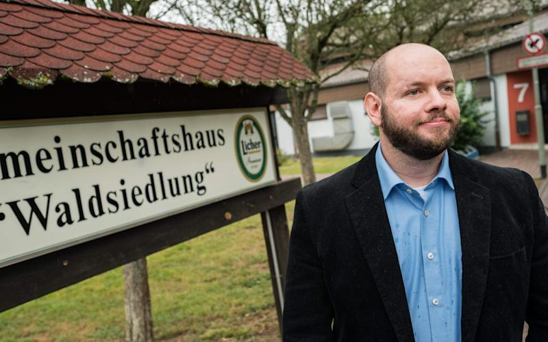 Stefan Jagsch of the far right-wing extremist National Democratic Party (NDP) poses for a photo in from of the community house in Altenstadt-Waldsiedlung, on September 8, 2019 - DPA