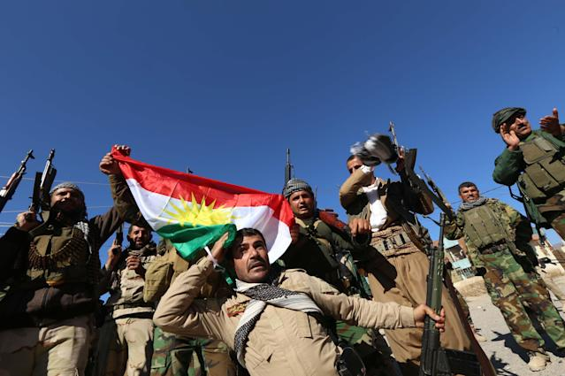 Iraqi autonomous Kurdish region's peshmerga forces and fighters from the Yazidi minority, a local Kurdish-speaking community which the Islamic State group had brutally targeted in the area. (Photo: Safin Hamed/AFP/Getty Images)