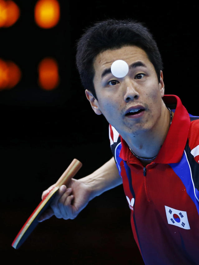 South Korea's Joo Saehyuk serves to Hong Kong's Jiang Tianyi in their men's team semifinals table tennis match at the ExCel venue during the London 2012 Olympic Games August 6, 2012. REUTERS/Darren Staples (BRITAIN - Tags: OLYMPICS SPORT TABLE TENNIS)