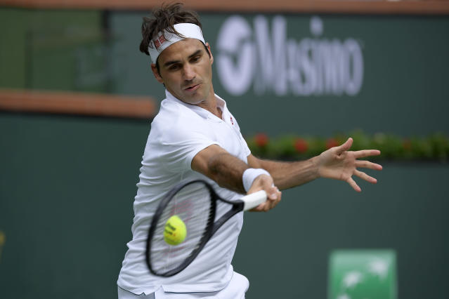 Roger Federer, of Switzerland, returns a shot to Peter Gojowczyk, of Germany, at the BNP Paribas Open tennis tournament Sunday, March 10, 2019, in Indian Wells, Calif. (AP Photo/Mark J. Terrill)