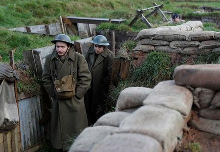 Actors Jake Morgan and Sam Ducane pose for photographs at the launch of the 1918 Poppy Pledge in a re-creation of a First World War trench at Pollock House in Glasgow, Scotland November 10, 2017. The actors appeared in the The Wipers Times, a play named after a magazine published by British soldiers in the First World War.  REUTERS/Russell Cheyne