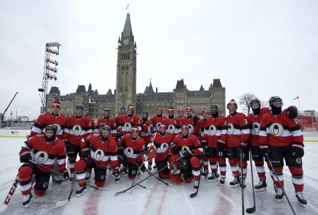 <p>Ottawa Senators pose for a team photo on the Canada 150 Rink on Parliament Hill, ahead of the NHL 100 Classic in Ottawa, which they won 3-0 over the Canadiens. </p>
