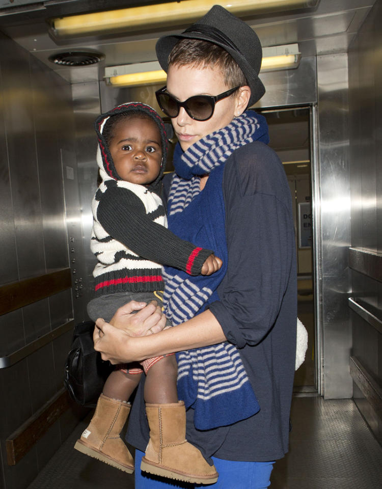 Oscar Winning actress Charlize Theron and her baby Jackson were seen arriving at LAX on a flight from Miami. Charlize and her son had just finished a two week vacation in Saint Barths in the South of France. Baby Jackson was wearing little baby UGG Boots. Pictured: Charlize Theron and Jackson Theron Ref: SPL477994  060113  Picture by: SPW / Splash News   Splash News and Pictures Los Angeles:310-821-2666 New York:212-619-2666 London:870-934-2666 photodesk@splashnews.com