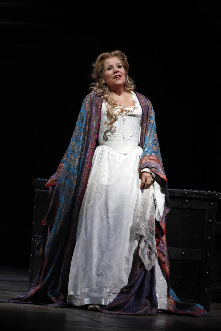 """FILE - In this Friday, Oct. 5 2012 file photo, soprano Renee Fleming performs as Desdemona during the final dress rehearsal of Guiseppe Verdi's """"Otello"""" at the Metropolitan Opera in New York. Fleming is participating along with Dr. Anthony Fauci, the CEO's of Moderna and Pfzer, and the lead guitarist of Aerosmith among others in a unique three-day Vatican conference starting Thursday, May 6, 2021, on COVID-19, other global health threats and how science, solidarity and spirituality can address them. (AP Photo/Mary Altaffer, file)"""