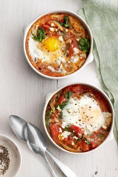 """<p>The kick of paprika in this bake will certainly wake you right up on January 1st. Serve with Bloody Marys for a true spice-lover's dream come true.</p><p><em><em><a href=""""https://www.goodhousekeeping.com/food-recipes/a15168/baked-eggs-spinach-tomato-recipe-clv0313/"""" rel=""""nofollow noopener"""" target=""""_blank"""" data-ylk=""""slk:Get the recipe for Baked Eggs with Spinach and Tomato »"""" class=""""link rapid-noclick-resp"""">Get the recipe for Baked Eggs with Spinach and Tomato »</a></em></em></p>"""